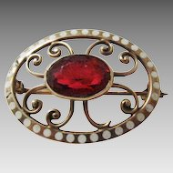 Nouveau 10 Karat Yellow Gold Pin with Beautiful Cranberry Glass Stone and Enamel Dot Surround