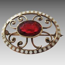 Nouveau 10 Karat Yellow Gold Pin with Beautiful Cranberry Glass Stone and Enamel Dot Surround