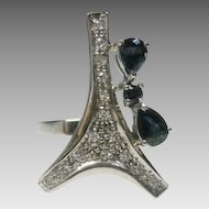 18 Karat White Gold Modernist Ring Enhanced with .80 cts Sapphire and 1 cts Diamond