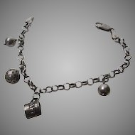 Sterling Silver  Charm Bracelet with Four Charms and Room for More