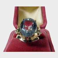 14 Karat Yellow Gold Ring With 6 Ct. Aquamarine Enhanced with Diamond Accents