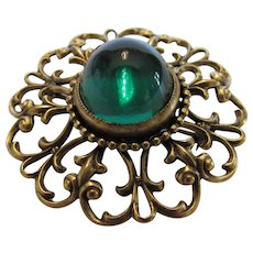 Joseff Signed Pin With Large Green Crystal Cabochon Surrounded by Goldtone Filagree
