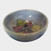 Moorcroft Mini Bowl in Red and Green Floral Accents With Light Blue Background