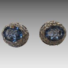 18 Karat White Gold Cornflower Blue Topaz and Diamond Surround Earrings