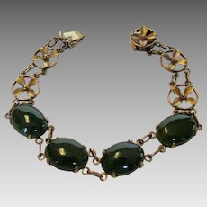 14 Karat Yellow Gold Jade Bracelet With Floral Segments and Clasp