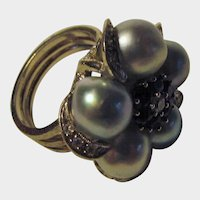 14 Karat White Gold Ring with Five Grey Cultured Pearls Surrounding a Sapphire Diamond Center