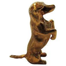 14 Karat Yellow Gold Tiny Begging Dachshund Brooch Accented With Ruby Eye