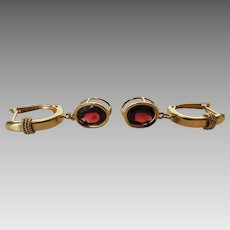 14 Karat Yellow Gold Earrings With Bezel Set Garnet Drops