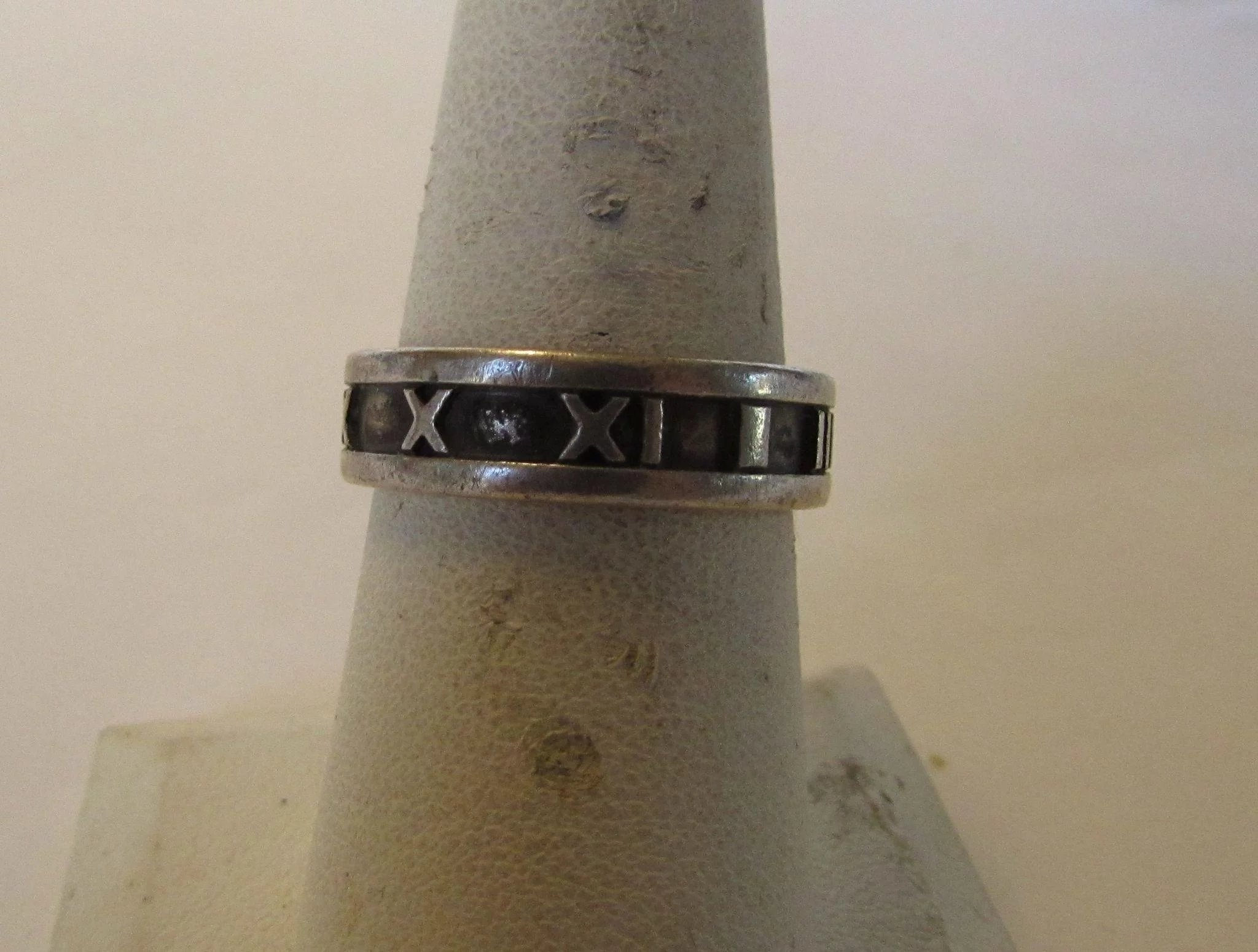 245513c48 Tiffany and Co. Sterling Roman Numeral Ring Dated 1995. Click to expand