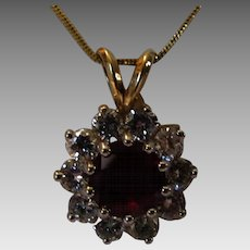 14 Karat Yellow Gold Ruby and Diamond Pendant on a 14 Karat Yellow Gold Chain