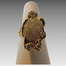 14 Karat Yellow Gold Carved Fire Opal Ring With Diamond Accents