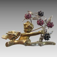 14 Karat Yellow Gold Cherub Pin Holding White Gold Bow Bouquet of Ruby and Sapphire with Diamond Accents