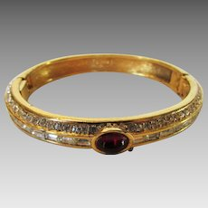 Fabulous  Vintage Ciner Bangle With Faux Ruby Cabochon Accented with a Variety of Crystals