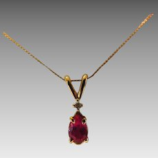 14 Karat Yellow Gold Ruby Petite Pendant With Diamond Chip Accent