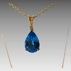 14 Karat Blue Topaz Pendant on a 14 Karat Chain With Diamond Chip Accents