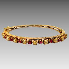 14 Karat Yellow Gold Ruby and Cultured Pearl Bangle