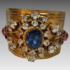 Vintage Early 20th Century Rigid Brass Bangle With Outstanding Blue, Pink and Clear Crystal Center