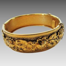 Vintage Goldtone Repousse Bangle With Floral Theme and Safety Chain