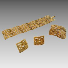 Vintage Crown Trifari Mid Century Goldtone Set including Bracelet, Pin and Matching Clip Earrings In Geometric Design