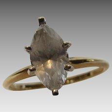 14 Karat Yellow Gold Ring Holding Solitaire Quartz Stone