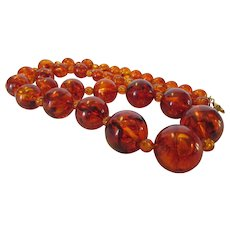 Vintage Necklace of Graduated Lucite Beads in Faux Amber Tone