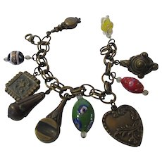 Vintage Bronze Tone Charm Bracelet With a Variety of Art Glass and Bronze Tone Charms