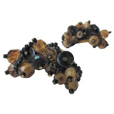 Vintage Hobe Goldtone Clip Earrings Featuring An Assortment of Navy and Amber Beads
