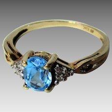 10 Karat Yellow Gold Blue Topaz and Diamond Ring