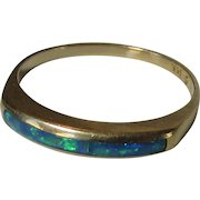 14 Karat Yellow Gold Band With Black Opals Across The Top