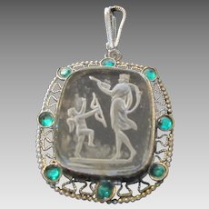 Vintage Carved Crystal Pendant of Diana in Silver Tone Frame With Green Crystal Accents