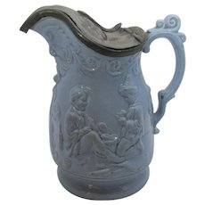 Victorian Blue Syrup Molded Pottery of Children Playing With Pewter Top