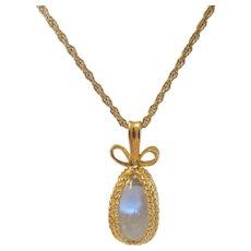 Vintage Joan Rivers Goldtone Crystal Egg Pendant in a  Goldtone Cage on Goldtone Chain