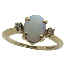 14 Karat Yellow Gold Opal Ring With Twin Tiny Diamond Accents