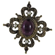 Vintage Pin in Faux Medieval Style in Goldtone With Large Center Red Crystal and Faux Pearl Surround