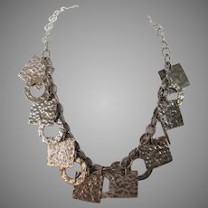 Sterling Silver Toggle Necklace With A Variety of Textured Shapes