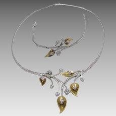 18 Karat White and Yellow Gold Necklace and Matching Bracelet With Cubic Zirconium Accents