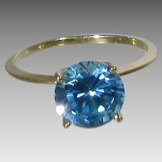 14 Karat Yellow Gold Band With Blue Topaz Solitaire