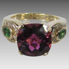14 Karat Yellow Le Vian Gold Ring With Center Cut Rubellite Tourmaline and Diamond Studded Tsovorite Garnet Shoulders