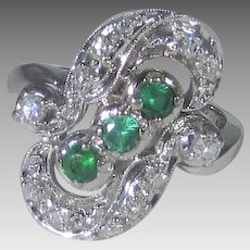 14 Karat White Gold Ring With Three Emeralds and 12 Diamond Accents