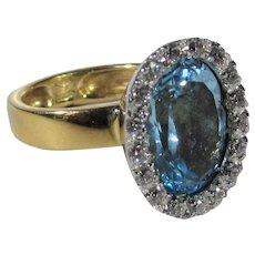 18 Karat Yellow and White Gold Blue Topaz Ring  With Diamond Halo