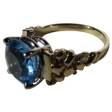 14 Karat Yellow Gold Blue Topaz Ring In Nugget Style Setting