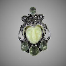 Sterling Silver Ring With Carved Lucite Maiden Enhanced With Peridot