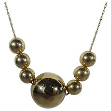 14 Karat Yellow Gold Necklace With 7 Gold Balls