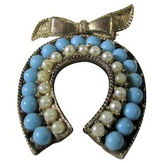 Vintage Horseshoe Pin With Faux Turquoise and Faux Pearls Hanging From Bow