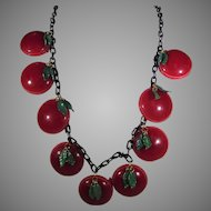 Bakelite Cherry Disk Necklace With Green Leaf Accents