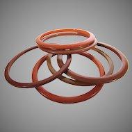 Bakelite Spacers 6 in a Variety of Orange and Brown