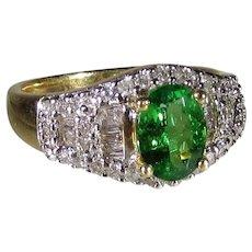 Tsavorite Garnet  Ring Surrounded by Round Baguette Diamonds in 14 Karat Yellow Gold