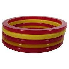 Bakelite Group of Five Spacers 3 in Cherry Red and 2 in Butterscotch