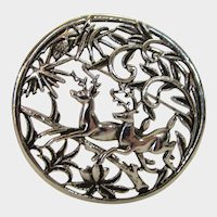 Vintage SIlver Tone Circular Pin Depicting Leaping Stags in A Forrest