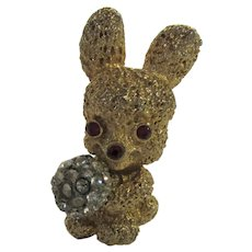 Vintage Goldtone Bunny Holding a Crystal Bouquet Pin